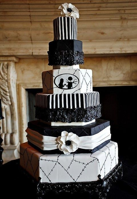 a black and white Nightmare Before Christmas wedding cake with various patterns and white blooms is a chic idea
