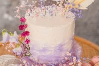 13 a lovely iridescent wedding cake with an ombre effect, lilac and pink blooms and number is a lovely idea for a bright wedding