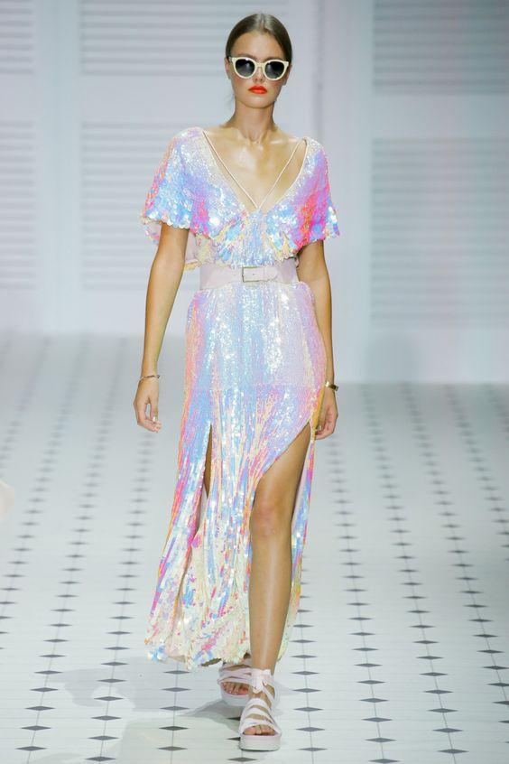 an iridescent midi A line wedding dress with straps and a deep V neckline, slits and white platform shoes