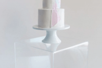 14 a white buttercream wedding cake decorated with holographic and pink shars is a very cool idea for an iridescent wedding