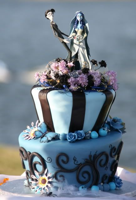 a blue and black wedding cake with butterflies, beads, lilac and black blooms and Victor and Sally cake toppers is cool