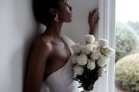 15 a chic and elegant white rose long stem wedding bouquet will never go out of style and will make your look very refined