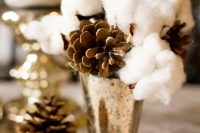 15 a pretty and simple winter wedding centerpiece of a shiny vase, pinecones and cotton is easy to compose and it looks unusual and fresh