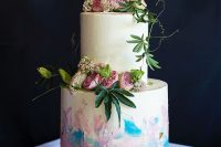 15 a white wedding cake with iridescent details and gold glitter, with fresh white and pink blooms and greenery