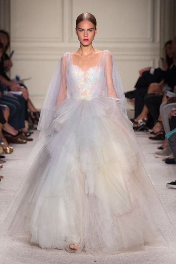a jaw-dropping iridescent wedding ballgown with a layered tulel skirt and a shiny iridescent bodice plus a capelet