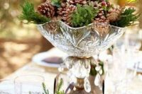 16 a pretty winter wedding centerpiece of a crystal bowl with pinecones, berries and evergreens is a delicate and cool idea for a woodland wedding