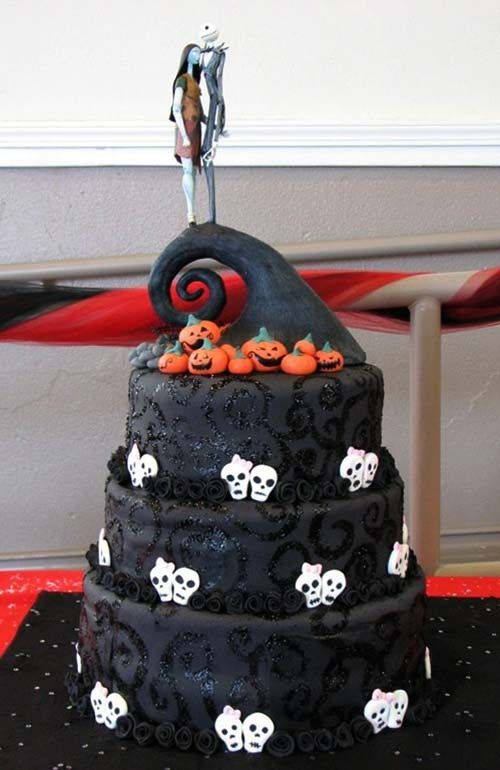 a bold Tim Burton wedding cake in black, with white skulls, pumpkinds, Jack and Sally cake toppers is wow