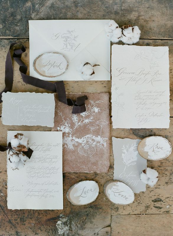 a delicate neutral winter wedding invitation suite with a raw edge and some painting is a lovely idea