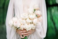 18 a dreamy and chic blush rose wedding bouquet with a catchy shape is a lovely idea for a modern or minimalist bride
