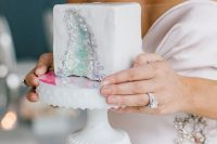 18 an white wedding cake with an iridescent geode detail is a lovely and chic idea with a touch of glam and a wow factor