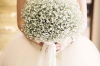 19 a dreamy wedding bouquet composed of only baby's breath and white ribbons is a very chic and very romantic idea