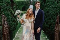 19 an iridescent wedding dress with slits, short sleeves, a V-neckline is a fantastic idea for a modern and daring couple