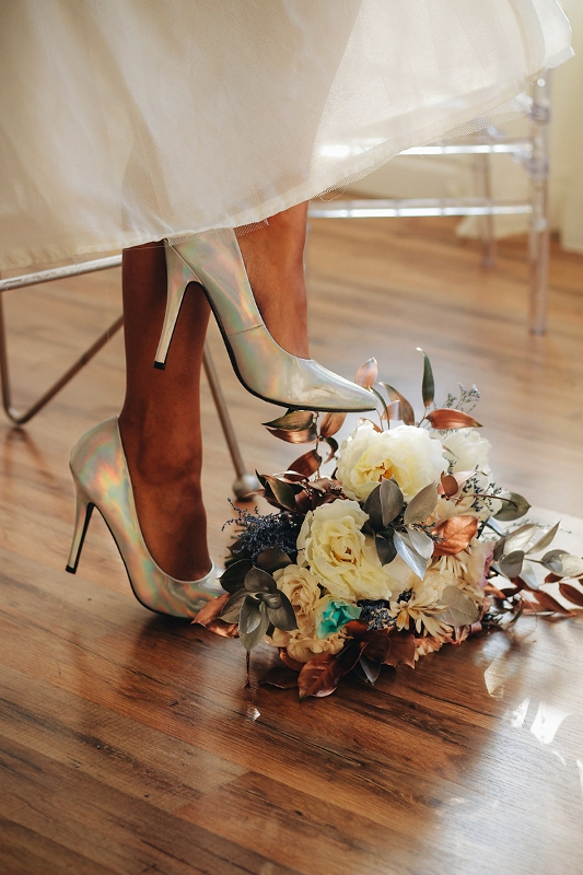 holographic wedding shoes are a bold touch for a modern bride who loves everything iridescent but isn't ready to wear such a dress