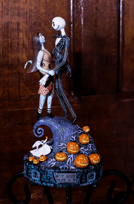 a fantastic Tim Burton wedding decoration With Sally and Jack, pumpkins, a ghost dog and a quote from the movie is amazing