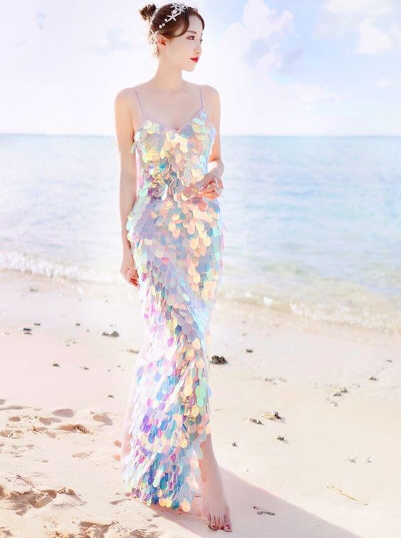 an iridescent fitting wedding dress with spaghetti straps is a cool idea for a coastal or beach wedding