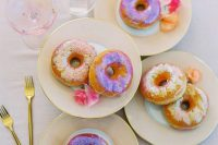 21 iridescent glazed donuts are a fantastic wedding food idea, they are an alternative to a wedding cake