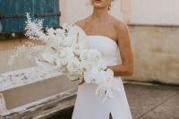 22 a lush white wedding bouquet with callas, orchids and some dried foliage, with a catchy shape and a cascading element is idea for a minimalist bride