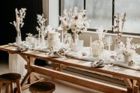23 an organic winter wedding tablescape with white blooms, dried flowers and grasses, cotton buds and all white everything