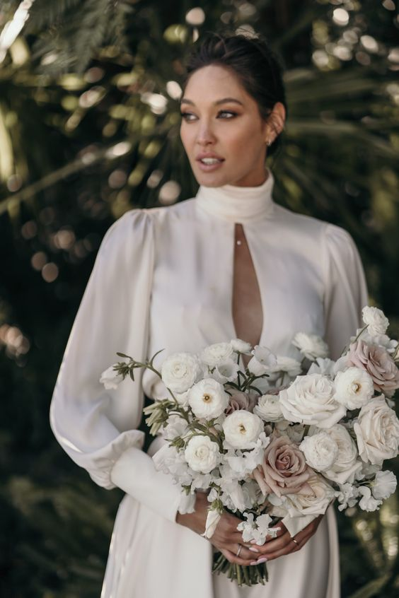 white and dusty pink roses and anemones for a lovely and delicate minimalist wedding bouquet with a slight touch of color