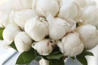 26 a white peony wedding bouquet is timeless classics that matches any bridal look and brings a touch of romance to it