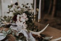 a wedding centerpiece with antlers is perfect for rustic look