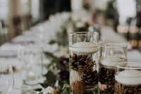 29 a greenery, blush rose wedding table runner, tall glasses with pinecones and floating candles for beautiful and a bit wild wedding decor