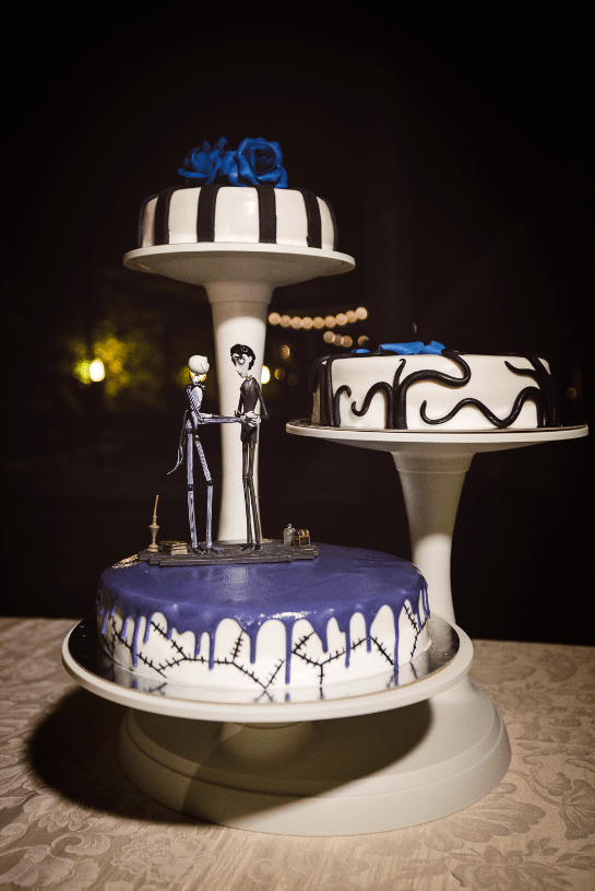 an assortment of wedding cakes inspired by Tim Burton are amazing for a themed same sex Halloween wedding