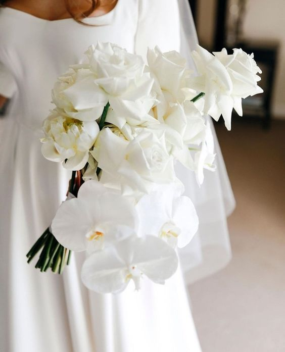 a sophisticated white rose and orchid wedding bouquet is a gorgeous idea for a modern or minimalist bride