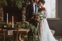 31 a super lush evergreen and pinecone plus greenery wedding table runner is a great idea for a cabin or just rustic winter wedding