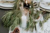 33 a winter wedding table runner of evergreens, various candles and pinecones plus neutral fabric is a great idea for a casual winter wedding