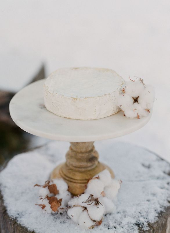 an alternative to a usual wedding cake   a cheese wheel with a cotton bud is a lovely idea for a winter wedding