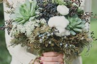 a beautiful textural winter wedding bouquet with cotton, succulents, privet berries and textural foliage is a very creative idea