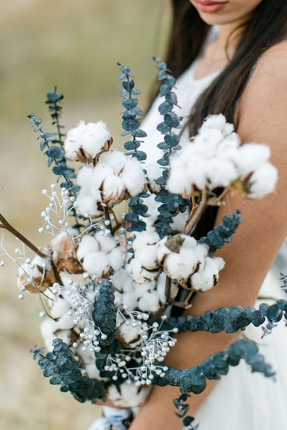 a beautiful wedding bouquet of silver dollar eucalyptus, cotton branches and silver berries is a gorgeous idea for a summer boho bride