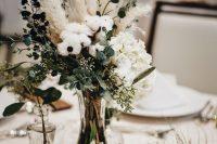 a cozy winter wedding centerpiece
