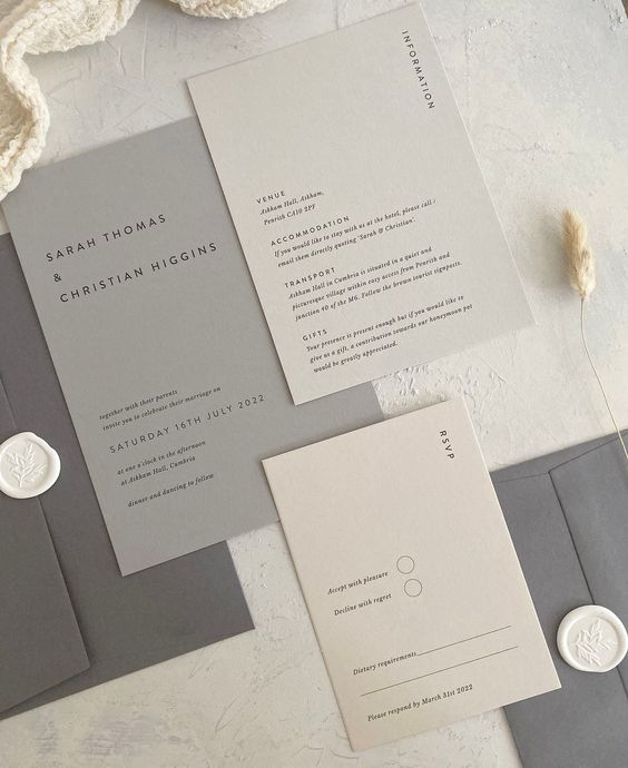 a chic minimalist wedding invitation suite in shades of grey and tan, with black lettering is a cool idea for a minimalist wedding