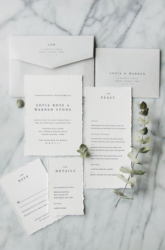 a clean minimalist wedding invitation suite with a raw edge and elegant envelopes is a gorgeous idea for a minimal wedding