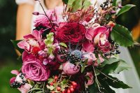 a colorful fall wedding bouquet of pink, fuchsia, burgundy blooms, several types of berries and lots of foliage is a lovely idea for the fall