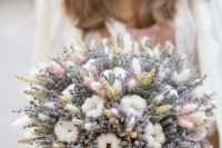 a cute wedding bouquet composed of lavender, cotton, wheat, bunny tails and with pink ribbons is a very cool idea