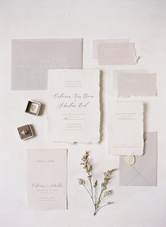 a delicate and ethereal light grey and white wedding invitation suite with a raw edge and calligraphy is a fantastic idea for a minimalist wedding