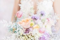 a delicate iridescent wedding bouquet with purple, lilac, pink, blush and white blooms and billy balls is a stylish idea