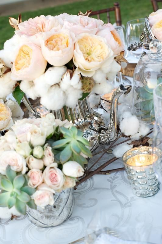 a delicate wedding centerpiece made of blush peony roses and cotton plus succulents and candles is a beautiful idea for a southern wedding