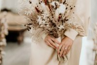 a cute dried flower wedding bouquet