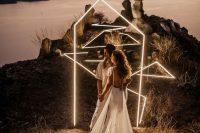 a stylish modern neon geometric wedding arch