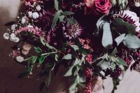 a gorgeous bold wedding bouquet with pink, blush, deep purple and white blooms of various kinds, greenery and some pink berries is cool for a fall bride
