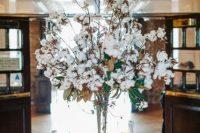 a cute tall winter wedding centerpiece