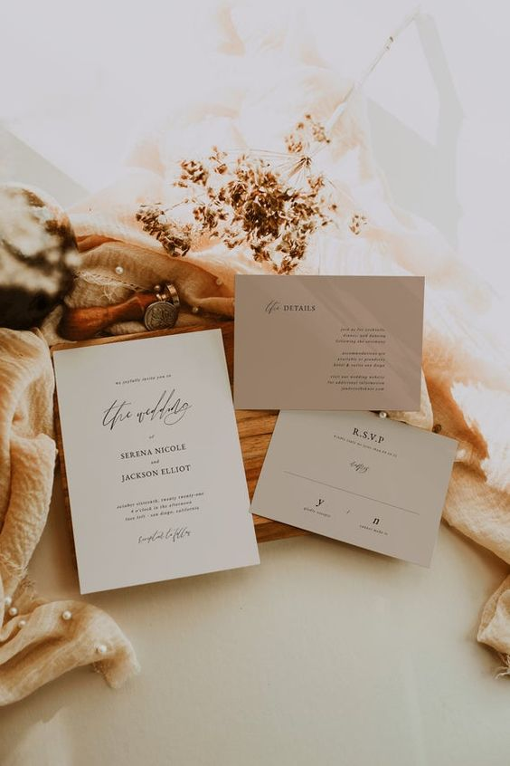 a grey and taupe minimalist wedding invitation suite with calligraphy and black lettering is a great idea for a minimal wedding