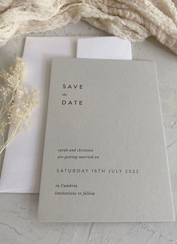 a light grey save the date and a white envelope will set the tone for your neutral minimalist wedding easily