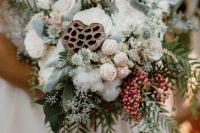 a lovely cascading wedding bouquet of blush and white blooms, cotton, lotus, berries and greenery is a lovely idea for a summer bride