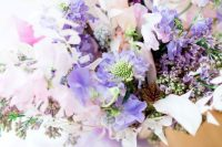 a lovely iridescent wedding bouquet with blush, purple, lilac blooms and holographic ribbons is a gorgeous idea