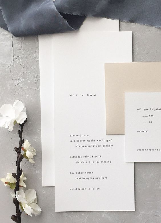 a lovely neutral wedding invitation suite in white and tan, with modern lettering and of simple shapes is a cool idea for a minimalist wedding
